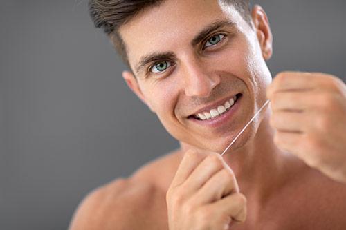 man-flossing-teeth